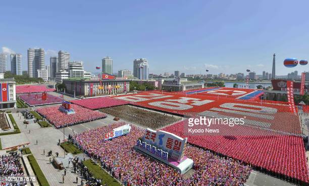 Citizens take part in a parade at Kim Il Sung Square in Pyongyang on Sept 9 to celebrate the 70th anniversary of the country's founding ==Kyodo