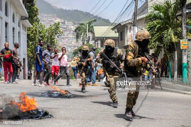Citizens take part in a protest near the police station of Petion Ville after Haitian president Jovenel Moïse was murdered on July 08, 2021 in...