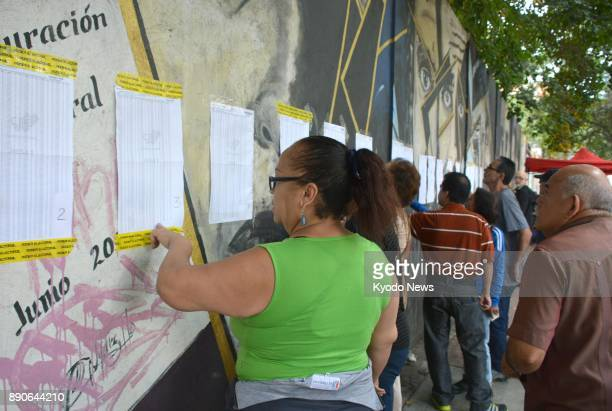 Citizens visit a polling station in Caracas Venezuela on Dec 10 2017 Mayoral elections held nationwide the same day brought a dominant victory to...