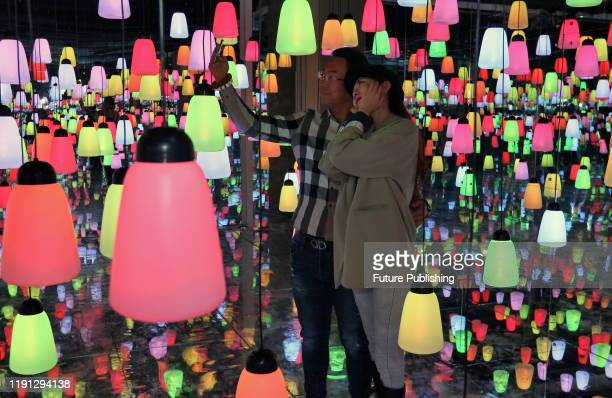 Citizens visit the immersive light and shadow interactive art exhibition to celebrate the new year, Yantai City, Shandong Province, China, January 1,...