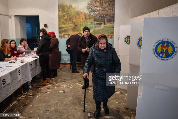 Citizens vote at a polling station in Bardar village on February 24 as Moldovans are called to the polls to elect new parliament members Tiny...