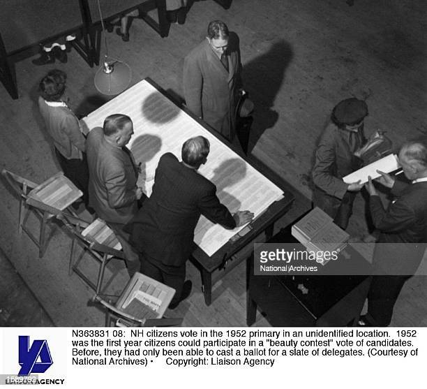 NH citizens vote in the 1952 primary in an unidentified location 1952 was the first year citizens could participate in a beauty contest vote of...