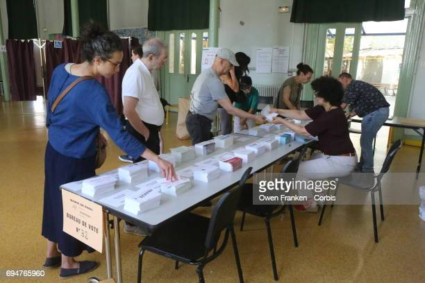 Citizens vote in the first round of elections for members of the French National Assembly their Parliament/Congress in the 11th Arrondissement on...