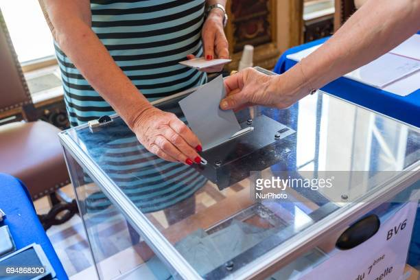 Citizens voting in the first round of elections for members of the French National Assembly, their Parliament/Congress on June 11, 2017 in Paris,...