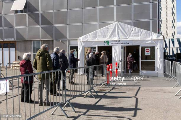 Citizens wait in line for a Covid-19 vaccination at the Bella Center on March 18, 2021 in Copenhagen, Denmark. At this vaccination center the...