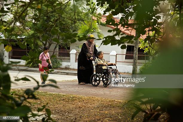 Citizens walk outside the Opera Estate Primary School one of the polling stations during the Singapore General Elections on September 11 2015
