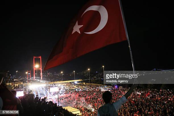 Citizens wave Turkish Flags during a march towards Bosphorus Bridge to protest Parallel State/Gulenist Terrorist Organization's failed military coup...