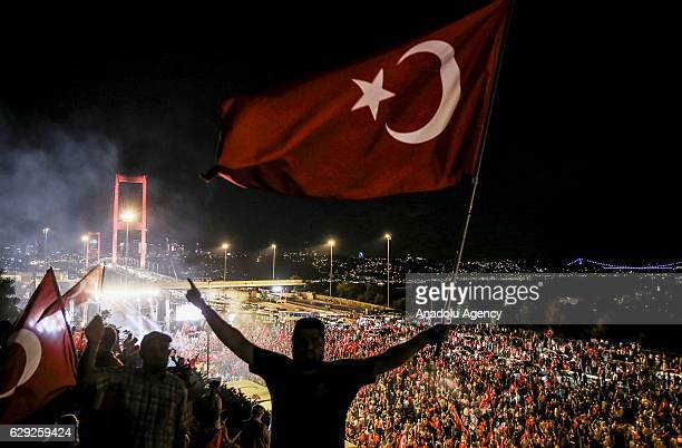 Citizens wave Turkish Flags during a march towards July 15 Martyrs' Bridge to protest Parallel State/Gulenist Terrorist Organization's failed...