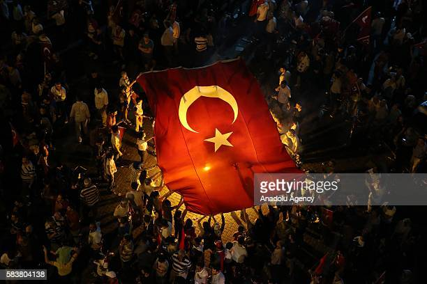 Citizens wave Turkish Flags during the democracy watch as people protest against Parallel State/Gulenist Terrorist Organization's failed military...