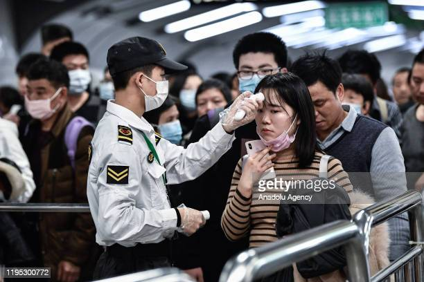 Citizens wear masks to defend against new viruses on January 222020 in Guangzhou ChinaThe 2019 new coronavirus known as 2019nCoV was discovered in...
