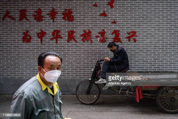 Citizens wear masks to protect against viruses on February 4,2020 in Guangzhou,China.According to statistics, as of February 4th at 21:00, the number...