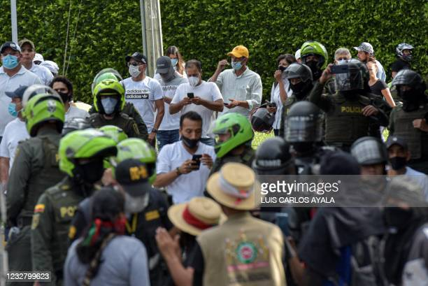 Citizens who oppose blockades set by demonstrators during protests triggered by a now abandoned tax reform are seen as clashes with indigenous people...