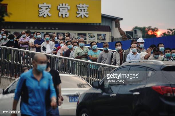 Citizens who visited or live near Xinfadi Market queue for a nucleic acid test on June 18 2020 in Beijing China The authorities in Beijing have begun...