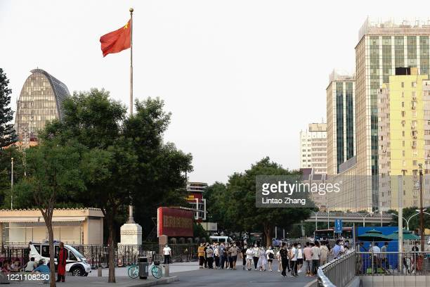 Citizens who visited or live near Xinfadi Market queue for a nucleic acid test on June 19 2020 in Beijing China The authorities in Beijing have begun...