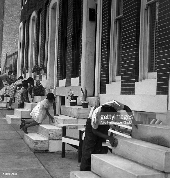 Citizens with row houses cleaning during the Afro American Newspapers Clean Block urban beautification campaign Baltimore Maryland June 28 1945