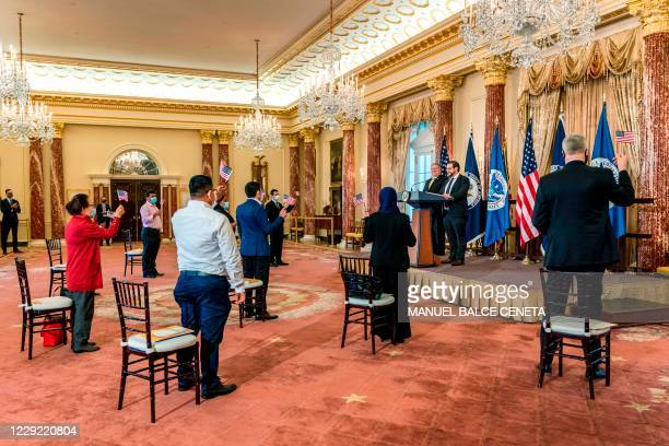 Citizenship and Immigration Services Deputy Director for Policy Joseph Edlow , with Secretary of State Mike Pompeo , administers the Oath of...