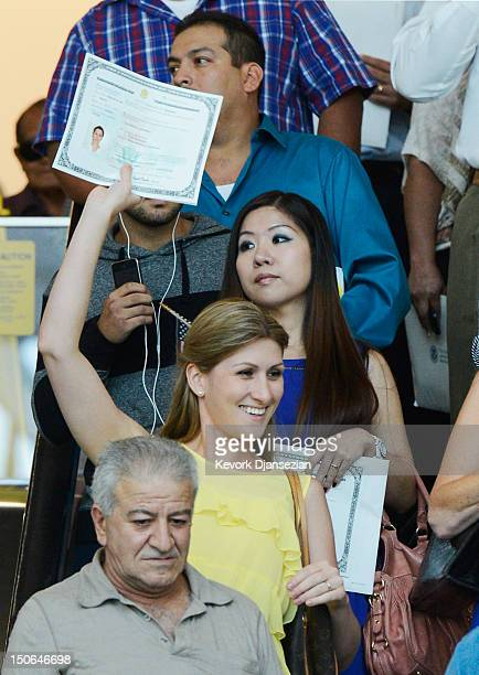 S citizenship candidates holds her certificate after taking the oath of citizenship at a naturalization ceremony at the Los Angeles Convention Center...