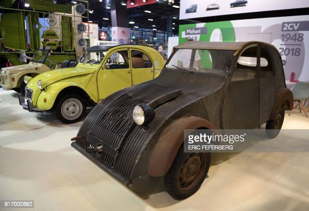 A Citroen 2CV and its ancestor the TPV are displayed at Retromobile an exhibition of vintage motor vehicles at Paris Expo in Porte de Versailles in...