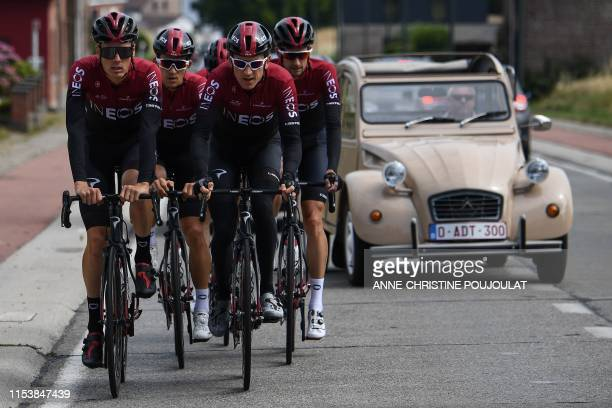 A Citroen 2CV car overpasses British rider Geraint Thomas and teammates as they take part in a training session of Great Britain's Team Ineos cycling...