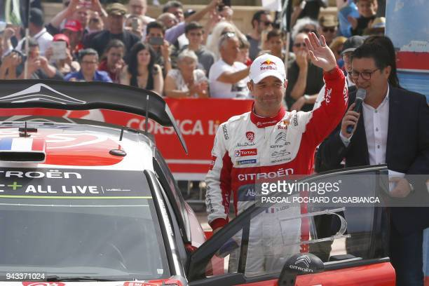 Citroen Abu Dhabi Total WRT team French driver Sebastien Loeb waves as he finish 10th of the Tour de Corse stage of the WRC Championship on April 8...