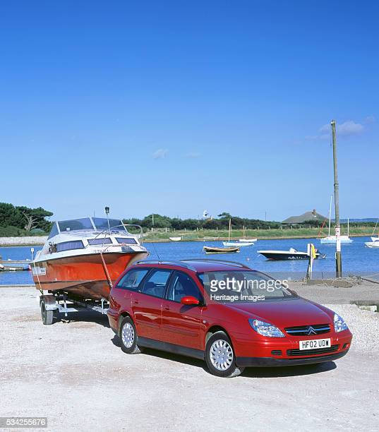 Citroen C5 hdi towing a boat by Keyhaven harbour 2000