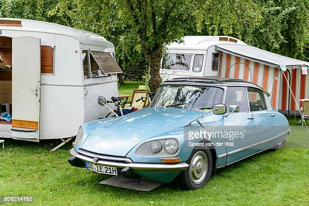 citroen ds classic french limousine car camping with old caravans - citroën ds stock photos and pictures