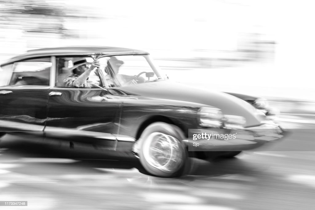 Citroen ID19 French limousine driving at high speed on a road : Stock Photo