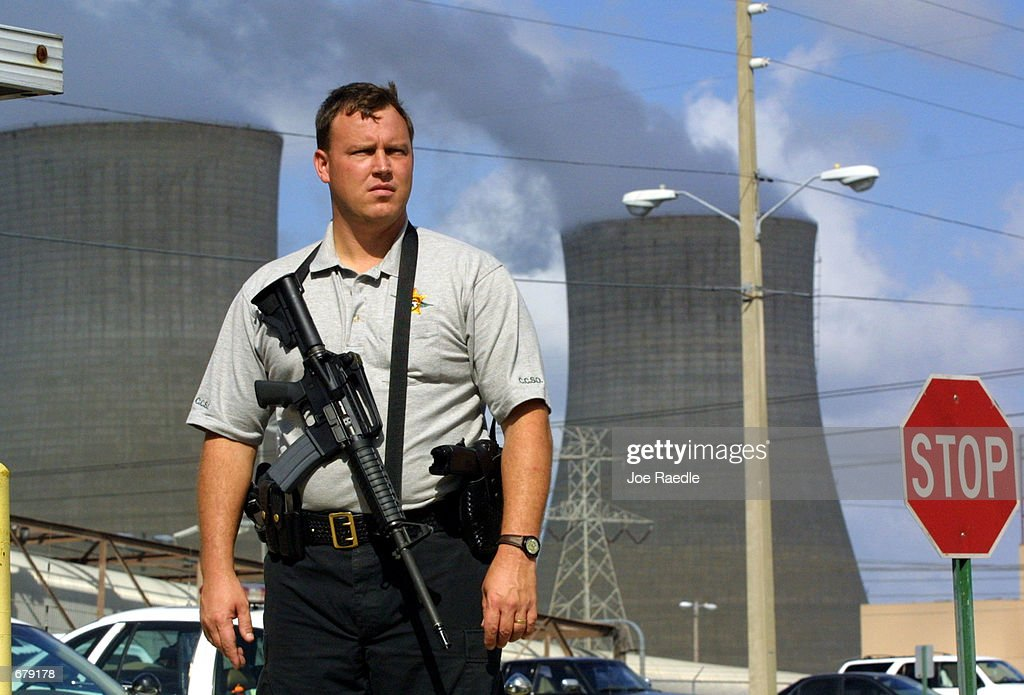 A Citrus County Sheriff officer stands guard at the entrance to the