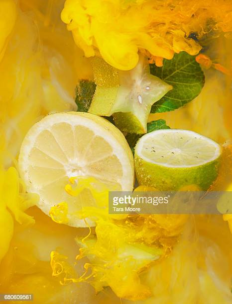 citrus fruit and ink shot underwater