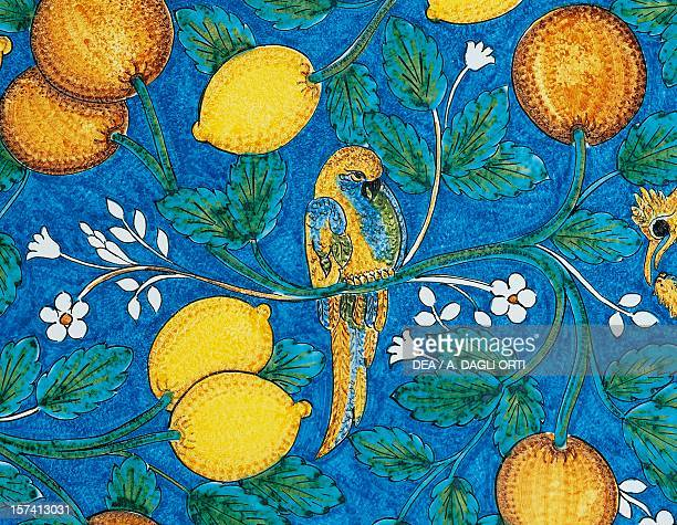Citrus fruit flowers and birds on a blue background decorative detail from a table lava stone maiolica Salvatore Gurreri manufacture Caltagirone...