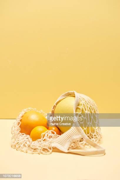 Citrus fruits in mesh bag