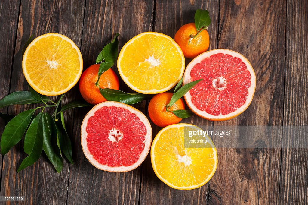 Citrus fruits. Over wooden table background : Stock Photo