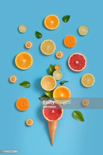 citrus fruits sorbet ice cream conceptual still life. - aliment surgelé photos et images de collection