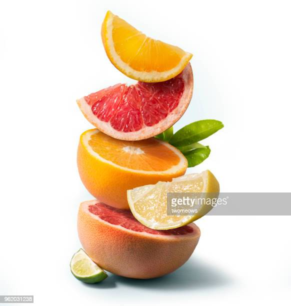 citrus fruits stack still life. - citrus fruit stock pictures, royalty-free photos & images