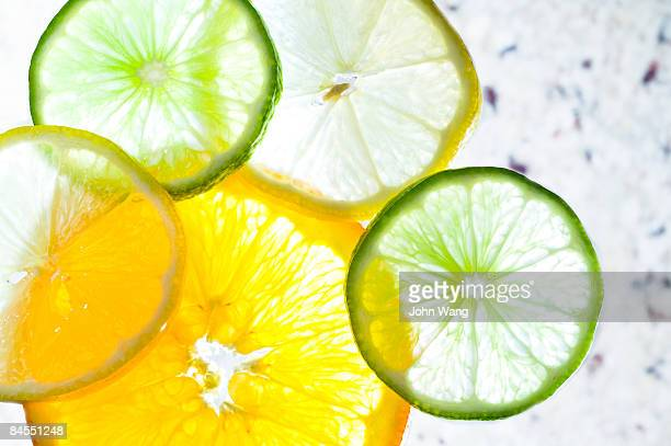 citrus slices on a marble stone background - citrus fruit stock pictures, royalty-free photos & images