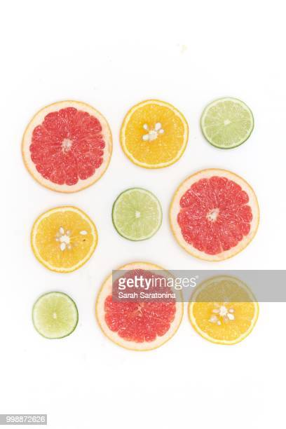citrus slices - citrus fruit stock pictures, royalty-free photos & images