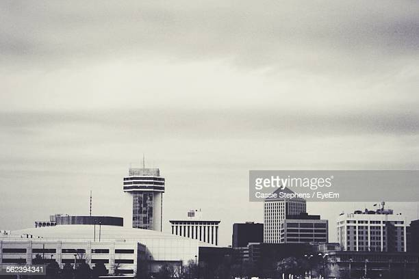 city against cloudy sky - wichita stock photos and pictures
