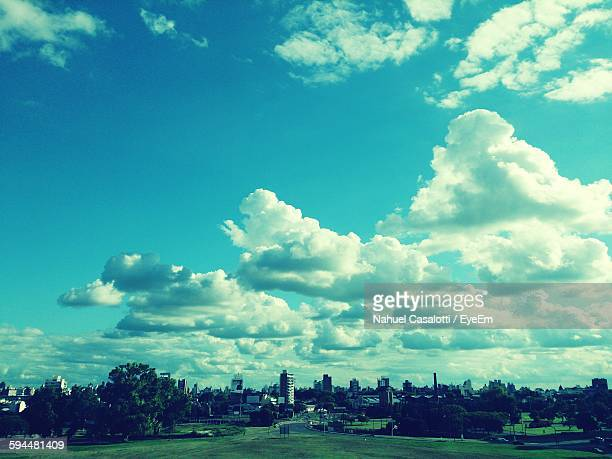 city against cloudy sky - santa fe province stock photos and pictures