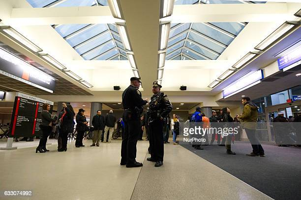 City Airport and Law Enforcement representatives discus plans for safe return of the thousands who turned out for a January 29th 2017 Immigration Ban...