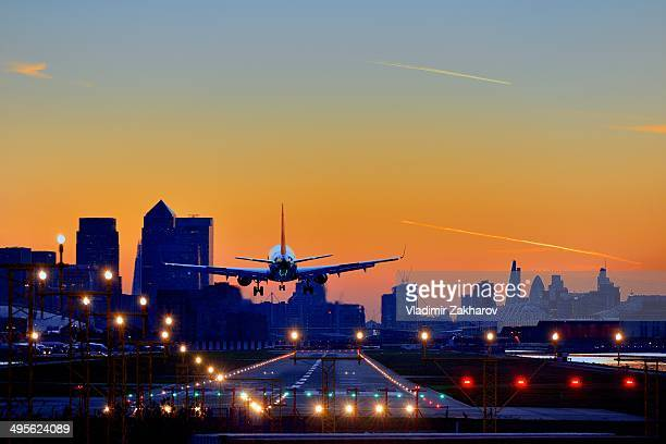 CONTENT] City Airport skyscrapers of Canary Wharf and The City seen at sunset