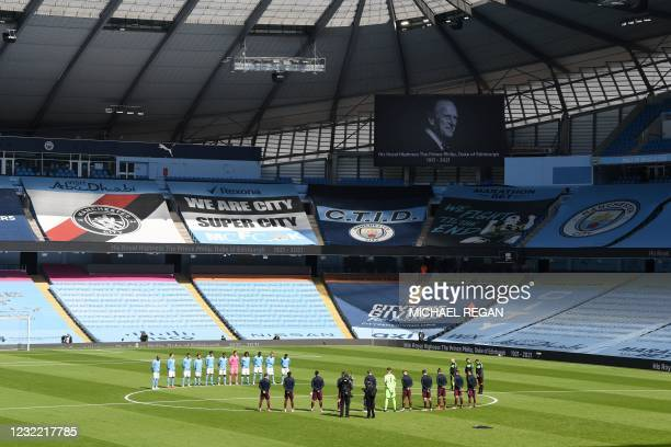 City and Leeds players observe a minute silence in honour of Britain's Prince Philip, Duke of Edinburgh, the day after the duke died at the age of...