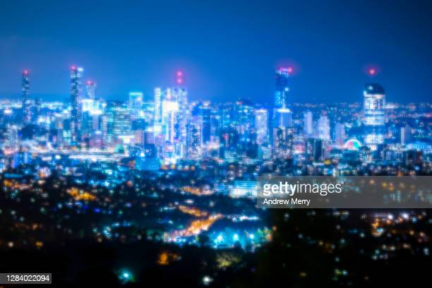 city at night, glowing, futuristic , digital enhancement - generic location stock pictures, royalty-free photos & images