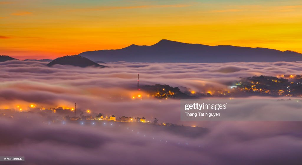 City at night in cloud - Dalat, Vietnam : Stock Photo