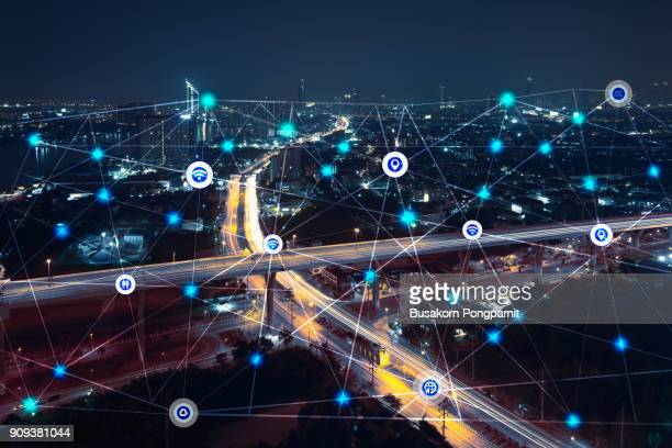 city at night with communication icons and network lines mix media concept background - de media stockfoto's en -beelden