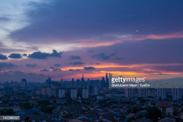city at sunset - shaifulzamri stock pictures, royalty-free photos & images
