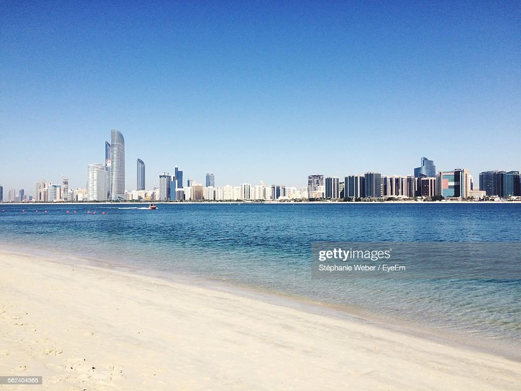 City At Waterfront Against Blue Sky : Stock Photo