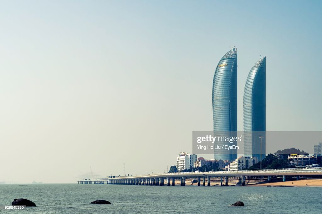 City At Waterfront Against Clear Sky : Stock Photo