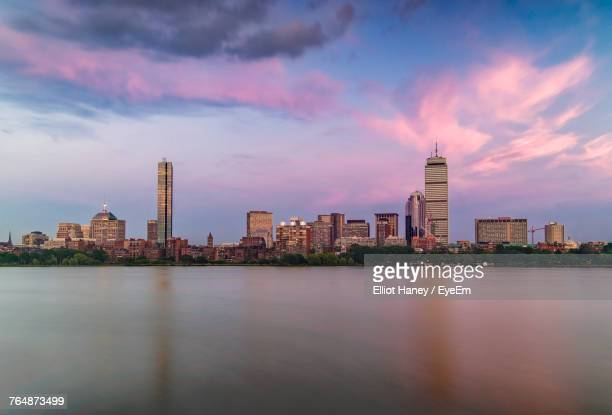 city at waterfront against cloudy sky - boston skyline stock pictures, royalty-free photos & images