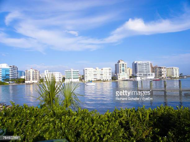city at waterfront against cloudy sky - sarasota stock photos and pictures