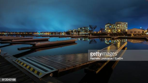 city at waterfront against cloudy sky - barrie stock pictures, royalty-free photos & images